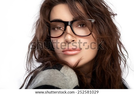 Gorgeous brunette fashion model girl with casual hairstyle wearing trendy glasses. Beauty fashion portrait isolated on white background with copy space - stock photo