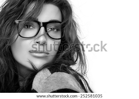 Gorgeous brunette fashion model girl with casual hairstyle wearing trendy glasses. Cool trendy eyewear portrait. Closeup in black and white with copy space for text - stock photo