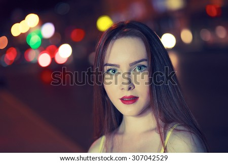 Gorgeous brunette girl portrait over night city defocused lights. Vogue fashion style portrait of young beautiful woman with long dark hair. Shallow DOF. Toned image with copyspace - stock photo