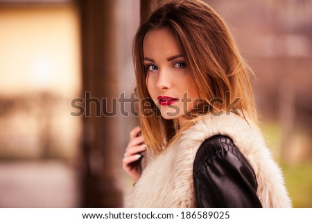 Gorgeous brunette standing on the train station portrait - stock photo