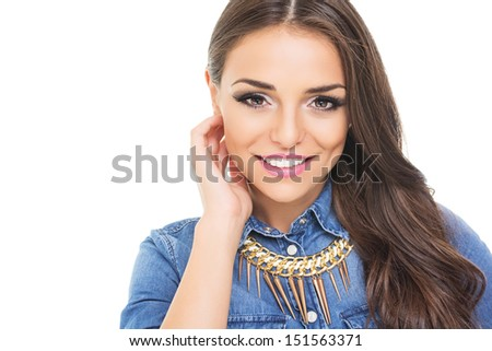Gorgeous brunette woman with fashionable necklace - stock photo