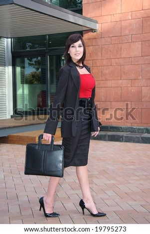 Gorgeous businesswoman walking with a briefcase