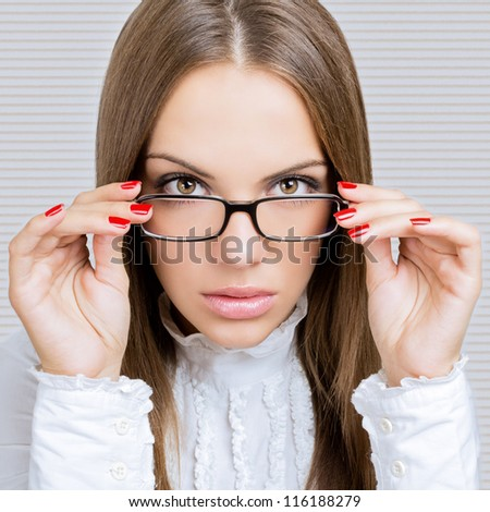 Gorgeous businesswoman with glasses - stock photo