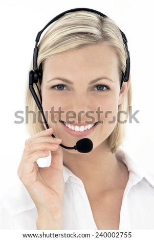 Gorgeous call center operator. Head and shoulders shot isolated on white. Woman in her twenties. - stock photo