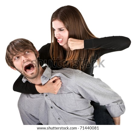 Gorgeous Caucasian woman threatens to punch boyfriend while he screams in fear - stock photo
