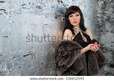 Gorgeous caucasian woman wearing fur coat and jewelry, horizontal shot - stock photo