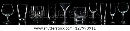gorgeous collection of drink glasses isolated on black background - stock photo