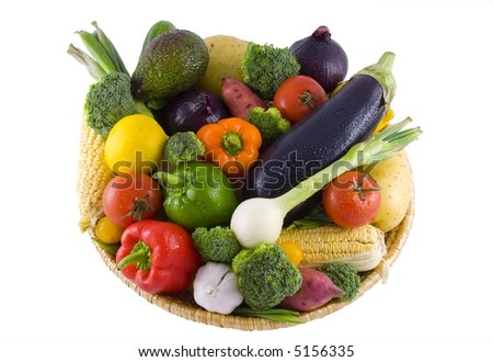 Gorgeous colorful basket of vegetables isolated on white - stock photo