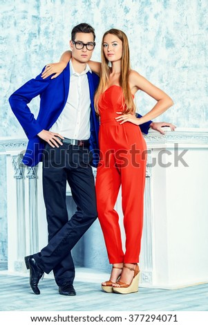 Gorgeous couple of young people stand in a room with vintage interior. Fashion shot. - stock photo