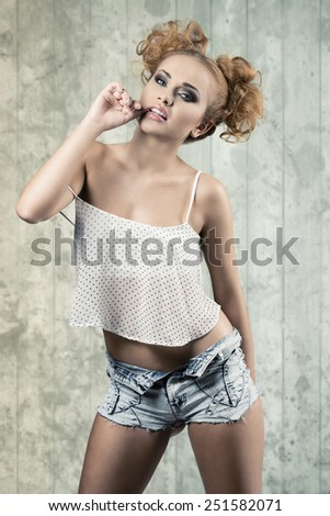 Gorgeous, crazy, pretty, redhead woman wears short top and shorts. She has hot nice hairstyle. - stock photo