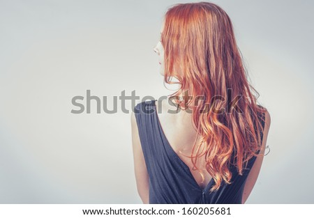Gorgeous curly redhead girls back. Toned image - stock photo