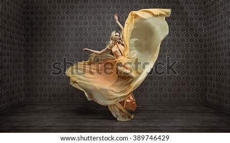 Gorgeous expressive blonde lady wearing fabulous dress - stock photo