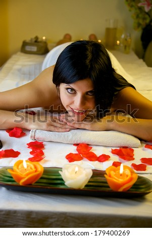 Gorgeous female model  brunette looking laying on massage table in vacation - stock photo