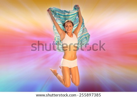 Gorgeous fit blonde jumping with scarf against abstract background - stock photo