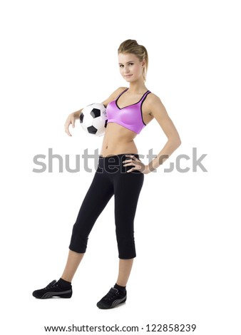 Gorgeous football player standing with a football against white background - stock photo