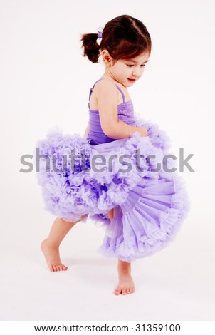 gorgeous girl dancing wearing a frilly lavender skirt - stock photo