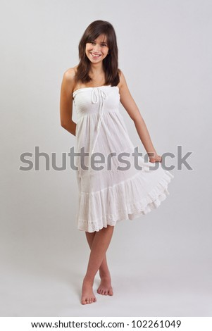 Gorgeous girl in cute white dress - stock photo