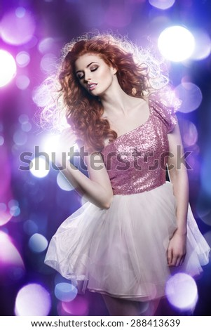 Gorgeous Girl in Glitzy Nightclub  - stock photo