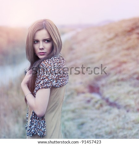 gorgeous girl posing in a field - stock photo