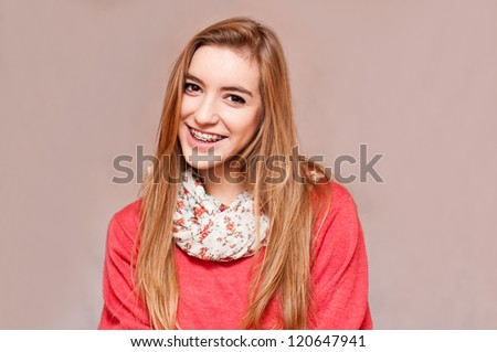 gorgeous girl smiling with her braces - stock photo