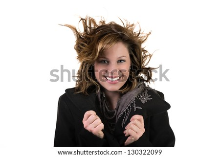 Gorgeous girl with hair flying in the wind - stock photo