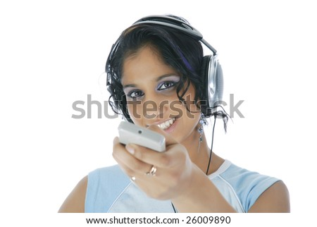 Gorgeous girl with remote control and headphones isolated over white - stock photo