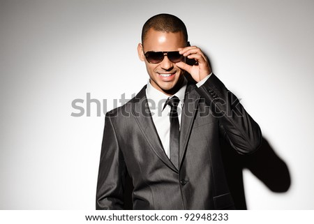 Gorgeous guy with SunGlasses smiling - stock photo