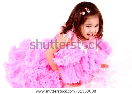 gorgeous happy girl wearing a frilly pink skirt - stock photo