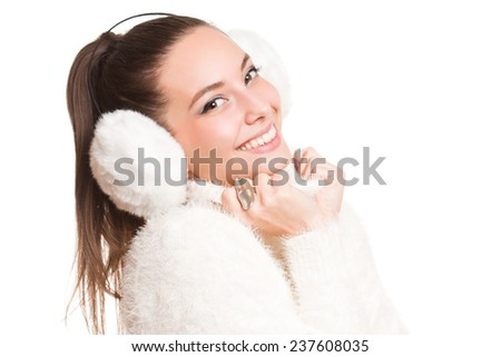 Gorgeous happy young brunette in warm winter weather clothes. - stock photo