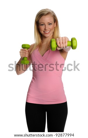 Gorgeous healthy blonde lifting weights - stock photo