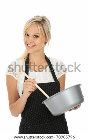 Gorgeous house wife in apron with cooking bowl and spoon - stock photo