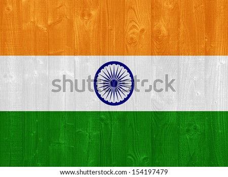 gorgeous India flag painted on a wood plank texture - stock photo