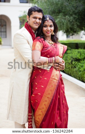 Gorgeous Indian bride and groom looking at camera