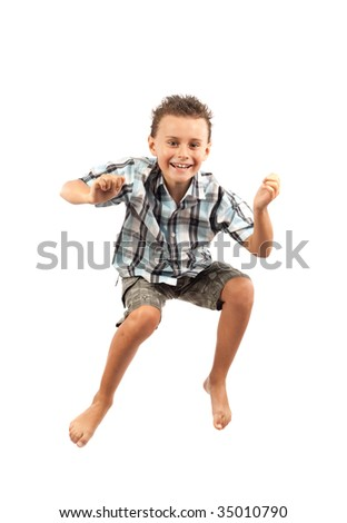 Gorgeous kid jumping for joy, isolated on white background - stock photo