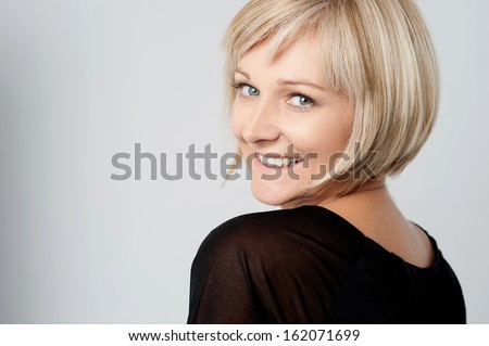 Gorgeous lady looking over her shoulder - stock photo