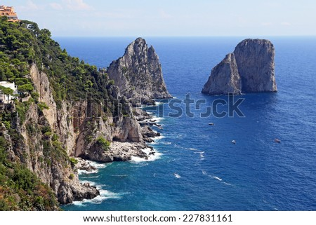Gorgeous landscape of famous faraglioni rocks on Capri island, Italy. Capri is located on Tyrrhenian sea. It has been a resort since the time of Roman Republic.