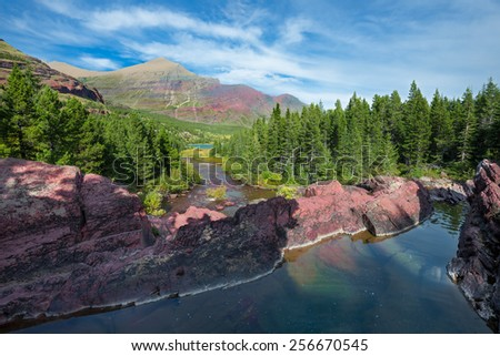 Gorgeous late afternoon mountain scene on Redrock Trail in east Glacier National Park, Montana - stock photo