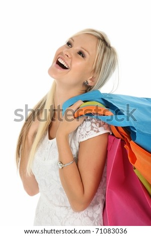 Gorgeous laughing blond woman with colorful shopping bags - stock photo