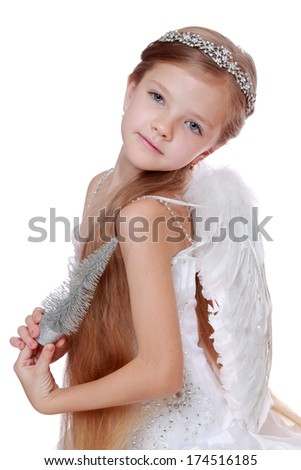 Gorgeous little angel isolated on white background on Holiday theme/Portrait of smiley little angel weasring gorgeous dress and posing on camera - stock photo