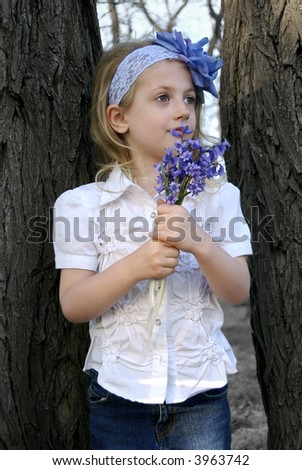 Gorgeous little girl posing with flowers - stock photo