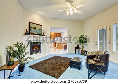 Gorgeous living room with bright blue carpet and nice decor. - stock photo