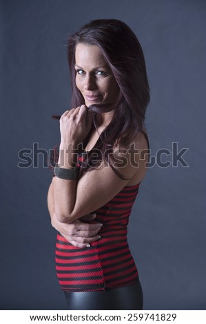 Gorgeous middle aged woman standing - stock photo