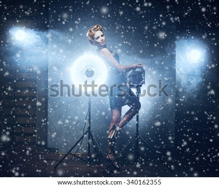 Gorgeous model in fashion dress over Christmas background (studio backstage). - stock photo