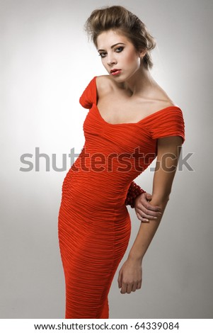 Gorgeous model in fashionable red gown - stock photo