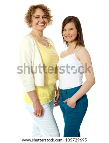 Gorgeous mother and daughter posing in front of camera. Smiling - stock photo