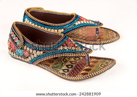Gorgeous pair of ethnic women footwear from India worn during wedding ceremony - stock photo