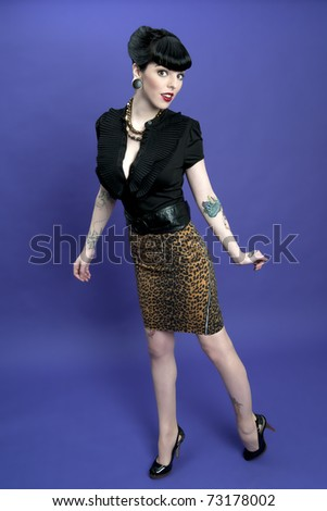 Gorgeous pinup model wearing leopard print skirt - stock photo