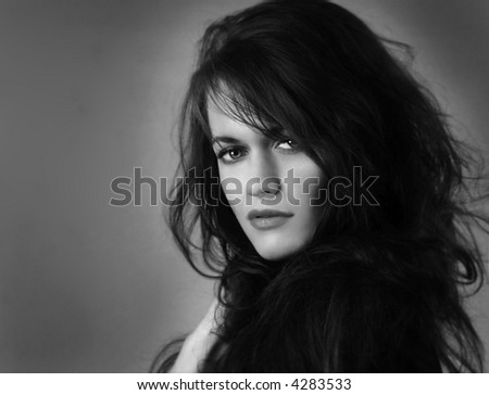 Gorgeous Portrait of a very beautiful woman on Grey - stock photo