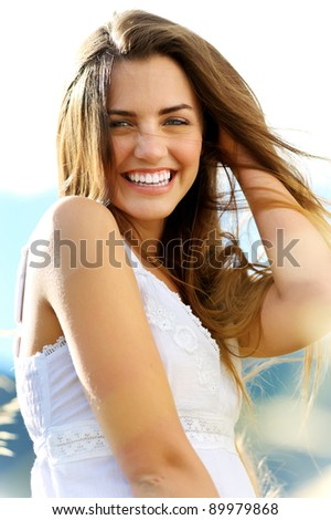 Gorgeous portrait of a young woman outdoors. beautiful smile and carefree attitude - stock photo