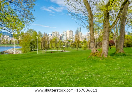 Gorgeous sea walk in the park. Kitsilano Beach Park in Vancouver. Canada. - stock photo